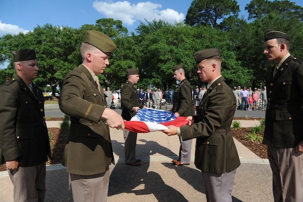 81st Security Forces Squadron Combat Arms Training and Maintenance members fold the U.S. flag during the Lt. Samuel Reeves Keesler, Jr. Memorial Retreat Ceremony May 13, 2016, Keesler Air Force Base, Miss. The event was held in honor of Lt. Keesler's date of entry into the Army Air Service 99 years ago. The retreat ceremony is part of a year-long celebration of Lt. Keesler, a Mississippi native and WORLD WAR I hero, and the 75th anniversary of the opening of the base. (U.S. Air Force photo by Kemberly Groue)
