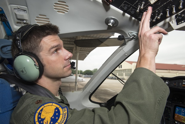 """Maj. Ryan Scott, 99th Flying Training Squadron """"A"""" flight commander and T-1A Jayhawk instructor pilot, checks the instrument panel of  a T-1A before a training mission at Joint Base San Antonio-Randolph May 16, 2016. The 99th FTS is the Department of Defense's sole provider for T-1A pilot instructor training."""
