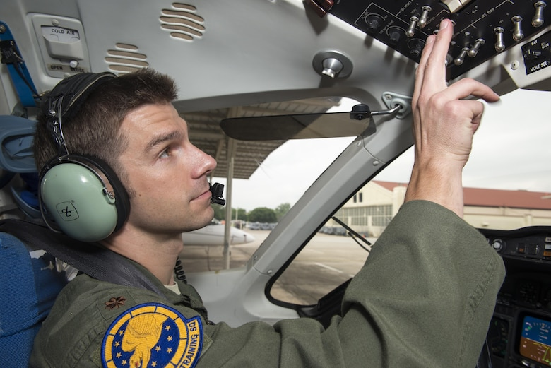"Maj. Ryan Scott, 99th Flying Training Squadron ""A"" flight commander and T-1A Jayhawk instructor pilot, checks the instrument panel of  a T-1A before a training mission at Joint Base San Antonio-Randolph May 16, 2016. The 99th FTS is the Department of Defense's sole provider for T-1A pilot instructor training."