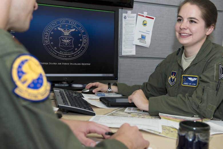 Second Lt. Aimee St. Cyr, 99th Flying Training Squadron instructor pilot trainee, gives a mission brief to her instructor pilot at Joint Base San Antonio-Randolph May 12, 2016. St. Cyr is a first assignment instructor pilot trainee and came to JBSA-Randolph after undergraduate pilot training.