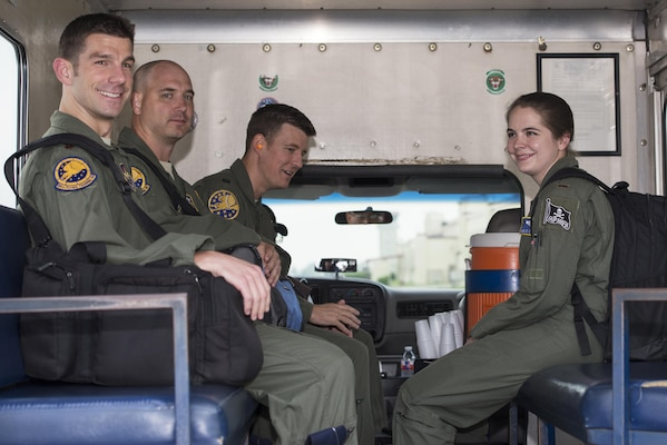 """Left to right: Maj. Ryan Scott, 99th Flying Training Squadron """"A"""" flight commander and T-1A Jayhawk instructor pilot, Maj. Brian Boettger, 99th FTS T-1A instructor pilot, Capt. Brad Davis, 99th FTS instructor pilot trainee and 2nd Lt. Aimee St. Cyr, 99th FTS instructor pilot trainee, are transported to their aircraft on the flightline of Joint Base San Antonio-Randolph May 12, 2016. This year marks the 23rd anniversary of the 99th FTS using the T-1A to train instructor pilots at JBSA-Randolph."""