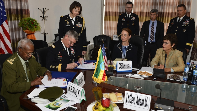 Army Gen. David M. Rodriguez, commander of Stuttgart, Germany-based U.S. Africa Command; and Gen. Samora Yunis, Chief of Staff Ethiopian National Defense Force, sign the summary of conclusions after a Bilateral Defense Committee meeting in Addis Ababa, Ethiopia, March 31, 2016. Rodriguez works with military leaders across the continent to build capabilities and encourage multinational coalitions. Air Force photo by Tech. Sgt. Dan DeCook