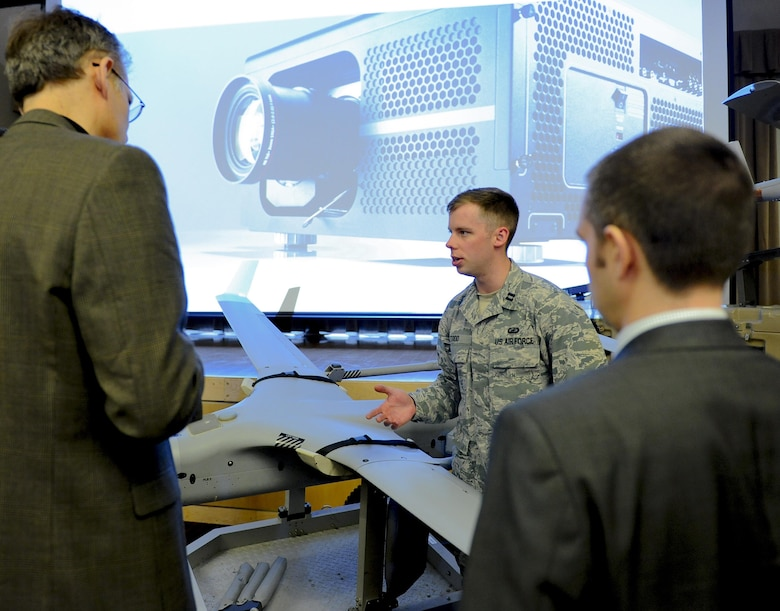Capt. Lee M. Todd, an engineer at the Air Force Research Laboratory, briefs media during the release of the Small Unmanned Aircraft System Flight Plan at the Pentagon Conference Center May 17, 2016, in Washington, D.C. Integration of SUAS into operations across all domains and levels of warfare will increase the Air Force's ability to meet emerging requirements of combatant commanders. (U.S. Air Force photo/Tech. Sgt. Anthony Nelson Jr.)