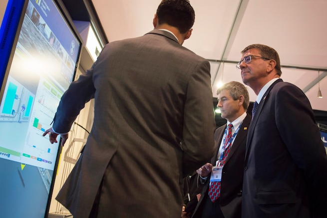 Defense Secretary Ash Carter speaks with an exhibitor at the Navy League's Sea-Air-Space Exposition at National Harbor, Md., May 17, 2016. Carter delivered remarked at the event. DoD photo by Air Force Senior Master Sgt. Adrian Cadiz