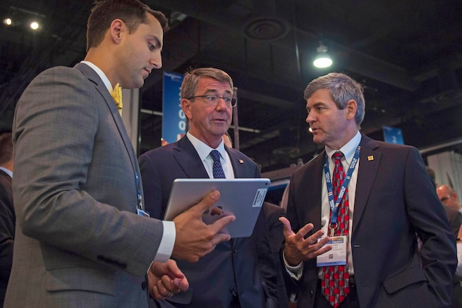 Defense Secretary Ash Carter speaks with an exhibitor during the Navy League's Sea-Air-Space Exposition at National Harbor, Md., May 17, 2016. DoD photo by Air Force Senior Master Sgt. Adrian Cadiz