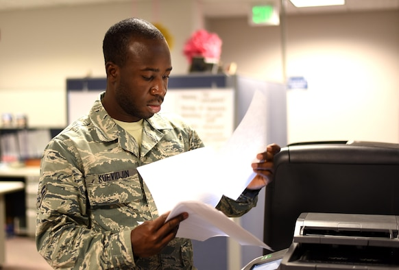 Airman 1st Class Folly Kuevidjin, a 21st Comptroller Squadron financial management specialist, scans and sends financial documents at Peterson Air Force Base, Colo., on May 17, 2016. Kuevidjin was tasked to support Operation Juniper Micron at the 768th Expeditionary Air Base Squadron in Niamey, Niger, as the main translator for the base, on call 24/7. (U.S. Air Force photo by Airman 1st Class Dennis Hoffman)