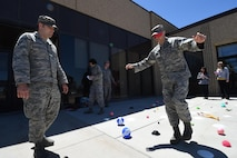 Senior Airman Nicholas Rogers, 50th Contracting Squadron, guides 1st Lt. Blake Ishmael, through a team building exercise during Wingman University at Schriever Air Force Base, Colorado, Thursday, May 12, 2016. Students were able to come together from different units and engage in classes that focused on Airmen resiliency, skill building, peer-to-peer cohesion and unit wellness. (U.S. Air Force photo/2nd Lt. Darren Domingo)