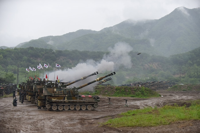 YEONCHEON, South Korea (May 10, 2016) - South Korean Soldiers from the 231st Field Artillery Battalion, 26th Mechanized Infantry Division Artillery, coordinate fires during a joint artillery exercise with U.S. Soldiers from the 1st Battalion, 82nd Field Artillery Regiment, 1st Armored Brigade Combat Team, 1st Cavalry Division. The exercise, less than six miles from the Demilitarized Zone that separates North and South Korea, involved 30 self-propelled artillery from the U.S. and South Korea.