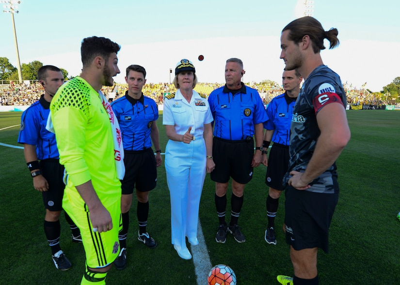 Commander, Naval Heath Clinic Charleston, Capt. Elizabeth Maley participated in the coin flip to begin the Charleston Battery Soccer game for their military appreciation night May 14, 2016, Charleston, S.C. The Charleston Battery cruised past Toronto FCII in a 2-0 victory. (U.S. Navy Photo by Mass Communication Specialist 1st Class Sean M. Stafford/Released)