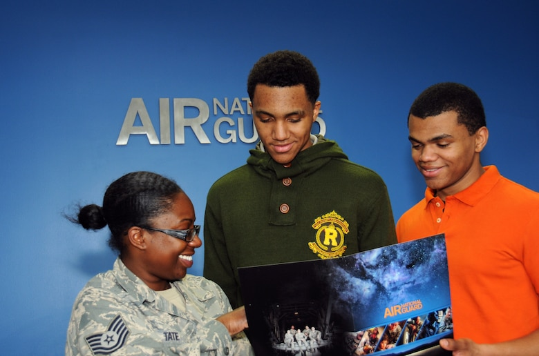 Tech. Sgt. Jovan K. Tate, a 111th Force Support Squadron retention office manager assistant, runs through a checklist with Airman 1st Class Kenneth Lassiter Jr., on left, and Airman 1st Class Xavier G. Lassiter, both members of the 111th Attack Wing Student Flight and slated for the 201st RED HORSE Squadron, Det. 1, at Horsham Air Guard Station, Pennsylvania, May 15, 2016 . Tate explained the benefits that will be available to fuel their future upon returning to the unit after Air Force Basic Military Training and technical training school. (U.S. Air National Guard photo by Staff Sgt. Michael Shaffer)