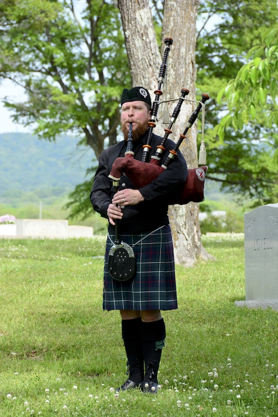 """A bagpiper from the Ian Sturrock Pipe Band plays during an annual wreath laying ceremony at the gravesite of Thomas """"Pete"""" Ray April 19, 2016. (U.S. Air National Guard photo by: Senior Master Sgt. Ken Johnson/Released)"""