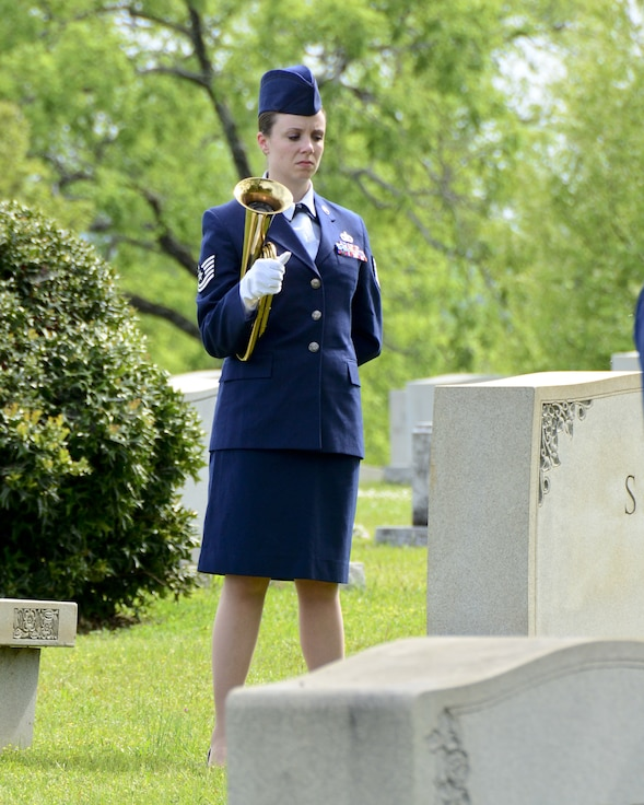 "Tech. Sgt. Emily Werth sounds Taps during an annual ceremony at the gravesite of Thomas ""Pete"" Ray as Lt. Col.Michael Metcalf laid a wreath in his honor. (U.S. Air National Guard photo by: Senior Master Sgt. Ken Johnson/Released)"