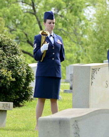 """Tech. Sgt. Emily Werth sounds Taps during an annual ceremony at the gravesite of Thomas """"Pete"""" Ray as Lt. Col.Michael Metcalf laid a wreath in his honor. (U.S. Air National Guard photo by: Senior Master Sgt. Ken Johnson/Released)"""