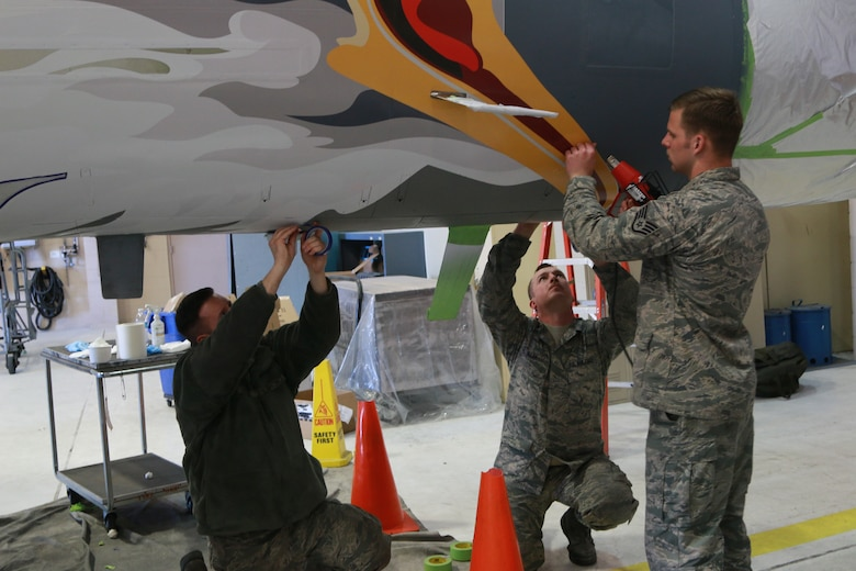 Airmen from the 173rd Maintenance Structural shop touch up the nose stencil of the screaming eagle on the ORANG 75th Anniversary F-15 Eagle. (U.S. Air National Guard photo by Master Sgt. Jennifer Shirar)