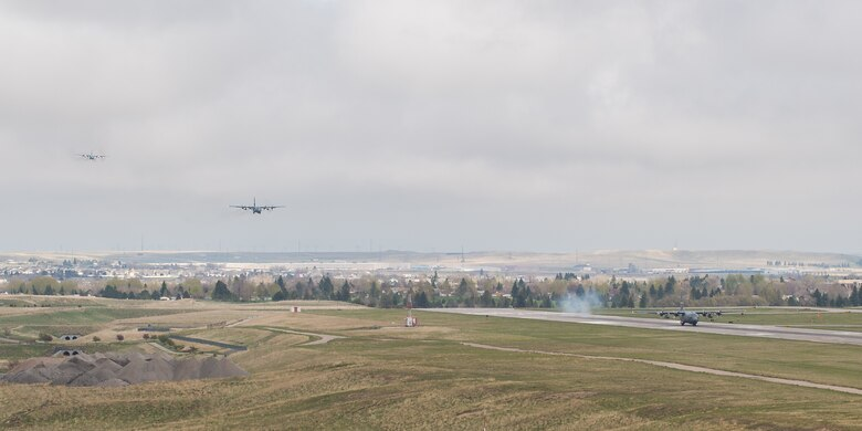 C-130 aircraft assigned to the 153rd Airlift Wing, Wyoming Air National Guard, Cheyenne, prepare to land May 14. The wing took part in a historic event when they successfully launched all eight assigned C-130H aircraft for a training mission - an operation of a scale never before seen in the history of the wing. (U.S. Air National Guard photo by Master Sgt. Charles Delano/released)