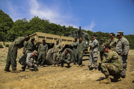 U.S. Marines train alongside U.S. Soldiers during Korea Explosive Ordnance Disposal Exercise, May 14, 2016, at Camp Rodriguez Live Fire Complex, South Korea. The Marines invited the Army to the exercise to increase EOD partnership and exchange different techniques and tactics. The Soldiers are EOD technicians with 718th EOD Company, 23rd Chemical Battalion, 48th Chemical Brigade. The Marines are EOD technicians with 3rd EOD Company, 9th Engineer Support Battalion, 3rd Marine Logistics Group, III Marine Expeditionary Force. (U.S. Marine Corps photo by Cpl. Isaac Ibarra/Released)