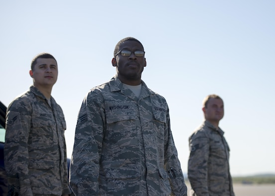 U.S. Air Force Airmen assigned to the 354th Medical Group (MDG) watch as a jet launches for a morning sortie during RED FLAG-Alaska 16-1, on May 12, 2015, Eielson Air Force Base, Alaska. Leadership within the 354 MDG sent small groups of Airmen to the flightline every morning during RF-A 16-1 to get a better understanding of the mission they support on a day-to-day basis. (U.S. Air Force photo by 1Lt Elias Zani/Released)