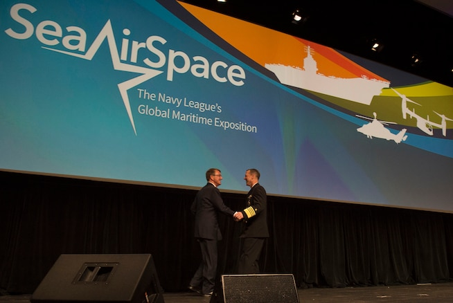 Chief of Naval Operations Adm. John M. Richardson welcomes Defense Secretary Ash Carter as the guest speaker during the Navy League's Sea-Air-Space Exposition at the Gaylord National Convention Center in National Harbor, Md., May 17, 2016. DoD photo by Air Force Senior Master Sgt. Adrian Cadiz