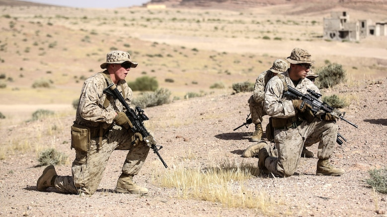Marines with 1st Battalion, 2nd Marine Regiment, 2nd Marine Division provide patrol security during a squad-level exercise in Al Quweyrah, Jordan, May 14. During the exercise, platoon commanders relayed combat scenarios to squad leaders, leaving in their hands how to respond using the Marines and capabilities at their command.