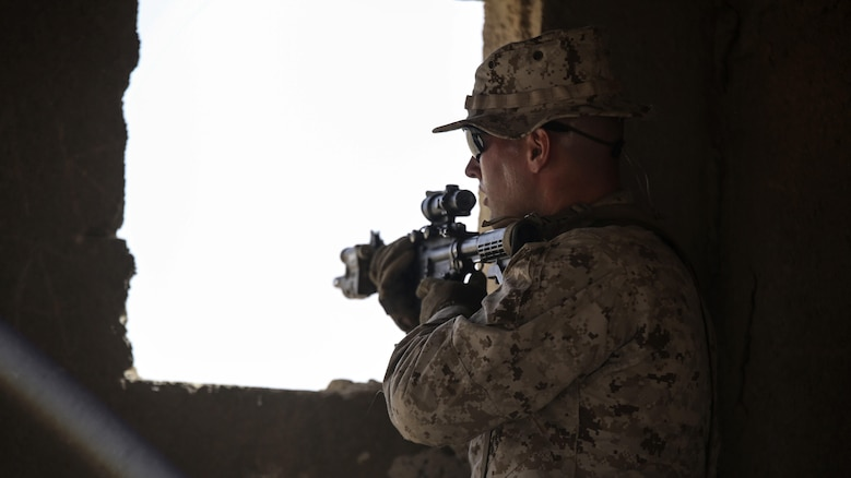 A Marine with 1st Battalion, 2nd Marine Regiment, 2nd Marine Division occupies an objective uring a squad-level exercise in Al Quweyrah, Jordan, May 14, 2016. During the exercise, platoon commanders relayed combat scenarios to squad leaders, delegating tactical decision-making down to the squad level.