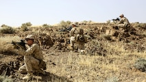 Marines with 1st Battalion, 2nd Marine Regiment, 2nd Marine Division provide patrol security during a squad-level exercise in Al Quweyrah, Jordan, May 14, 2016. Machine gunners and assaultmen occupied support-by-fire positions to assist squads as they advanced on lower ground.