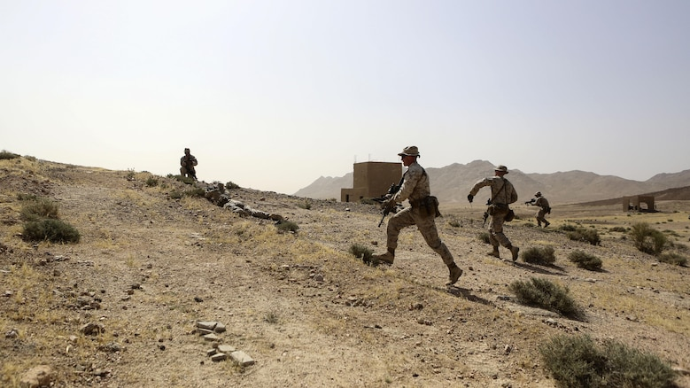 Marines with 1st Battalion, 2nd Marine Regiment, 2nd Marine Division advance on an objective during a squad-level exercise in Al Quweyrah, Jordan, May 14, 2016. During the exercise, platoon commanders relayed combat scenarios to squad leaders, delegating tactical decision-making down to the squad level.