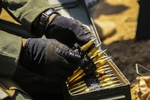 A Marine Explosive Ordnance Disposal technician prepares to stage .50 Caliber rounds to perform burning operations during Korea EOD Exercise May 14, 2016, at Camp Rodriguez Live Fire Complex, South Korea. The Marines ignited repellent charges to train for disposing of ammunition that can no longer be used. The Marines are with 3rd EOD Company, 9th Engineer Support Battalion, 3rd Marine Logistics Group, III Marine Expeditionary Force. (U.S. Marine Corps photo by Cpl. Isaac Ibarra/Released)