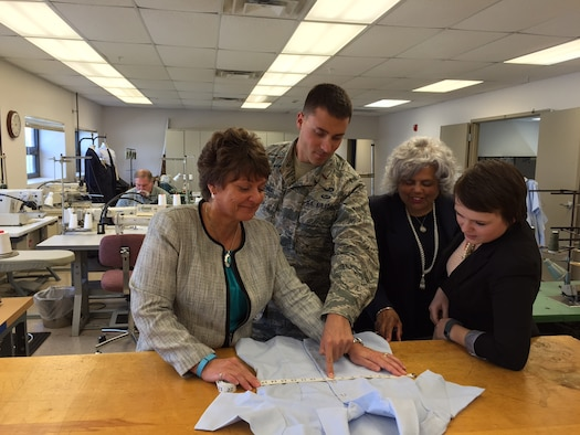 Reviewing a prototype women's service dress uniform overblouse, left to right, at the Air Force Uniform Office, Air Force Life Cycle Management Center on Wright-Patterson Air Force Base, Ohio, are Tracy Roan, the clothing designer; 2nd Lt. Adam Samlowski, the program manager; Yvonne Wilson, the section chief, clothing and textiles; and Maggie Tanner, the pattern designer. (Skywrighter photo/Amy Rollins)