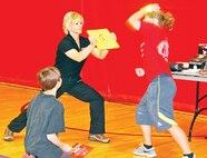 Third-degree black belt Koreen Carlton teaches students a few things about Taekwondo at the Fort Riley Middle School Wellness Fair April 29.