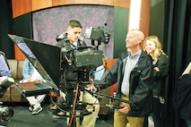 """Bob Everdeen, director of the U.S. Army Garrison Fort Riley Public Affairs Office, relives his days as a broadcast journalist while touring the student television station in Dole Hall on Kansas State University April 29. """"This helps us better understand what the students are going through here and we already know our side of it, so how can we work better together,"""" Everdeen said."""