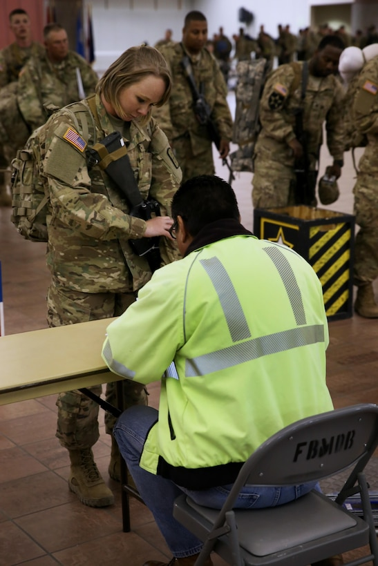 Soldiers assigned to the 863rd Engineer Battalion, 282nd Engineer Company, 945th Engineer Detachment, 313th Survey and Design Engineer Detachment, all Army Reserve units, and the 204th Engineer Detachment, Ohio Army National Guard, are processed and manifested prior to boarding at the Silas L. Copeland Arrival/Departure Airfield Control Group here May 2.