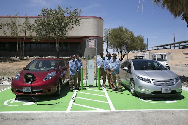 Public Works Division personnel finish installing one of the three electric vehicle charging stations aboard the Combat Center. (Official Marine Corps photo by Lance Cpl. Dave Flores)
