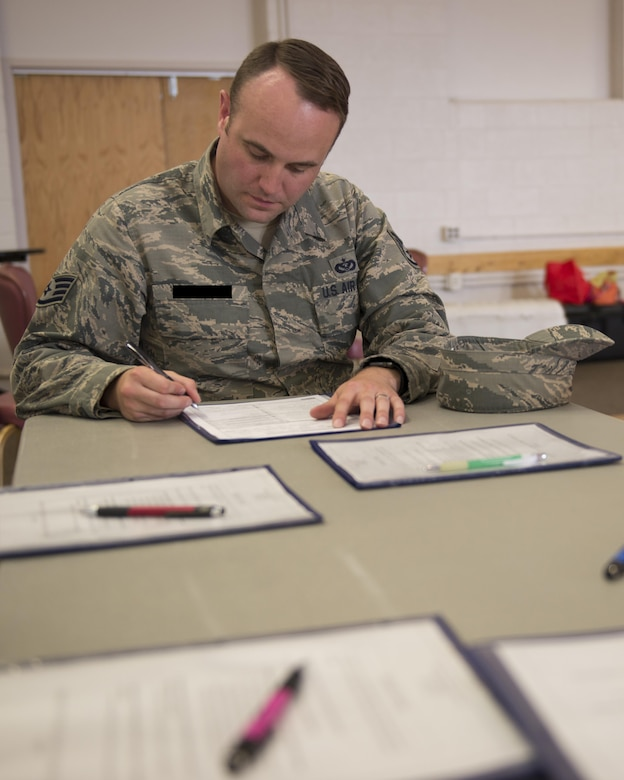 Staff Sgt. Scott, a 49th Materiel Maintenance Squadron heating, ventilation and air conditioning craftsman, fills out a sign-up sheet to donate blood here May 17. Participants register themselves then answer some questions about their health and travel history during a private interview. Donors make their donation and have a snack before they leave. Donating blood is a simple process that can save lives in an emergency. (Last names are being withheld due to operational requirements. U.S. Air Force photo by Airman 1st Class Randahl J. Jenson)