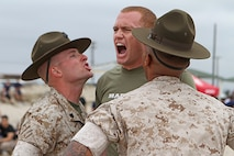 Trevor Londergan, an officer candidate of Officer Selection Station Los Angeles, responds to Marine Corps drill instructors as they give him commands during the Recruiting Station Los Angeles Annual Pool Function at Point Mugu Beach, May 14, 2016. Los Angeles Marines and more than 600 of their poolees participated in the 2016 annual pool function. After nearly six hours of competing in pull-ups, crunches, fitness relays, tug-of-war, and many other activities, RSS Lancaster came out on top as the RSLA pool function champions. (U.S. Marine Corps photo by Staff Sgt. Alicia R. Leaders/Released)