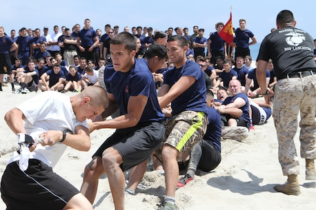 Recruiting Sub Station Lancaster poolees participate tug-of-war during Recruiting Station Los Angeles' Annual Pool Function at Point Mugu Beach, May 14, 2016. Los Angeles Marines and more than 600 of their poolees participated in the 2016 annual pool function. After nearly six hours of competing in pull-ups, crunches, sprint relays, tug-of-war, and many other activities, RSS Lancaster came out on top as the RSLA pool function champions. (U.S. Marine Corps photo by Staff Sgt. Alicia R. Leaders/Released)