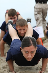 Recruiting Sub Station Culver City poolees participate in squad push-ups during Recruiting Station Los Angeles' Annual Pool Function at Point Mugu Beach, May 14, 2016. Los Angeles Marines and more than 600 of their poolees participated in the 2016 annual pool function. After nearly six hours of competing in pull-ups, crunches, fitness relays, tug-of-war, and many other activities, RSS Lancaster came out on top as the RSLA pool function champions. (U.S. Marine Corps photo by Staff Sgt. Alicia R. Leaders/Released)