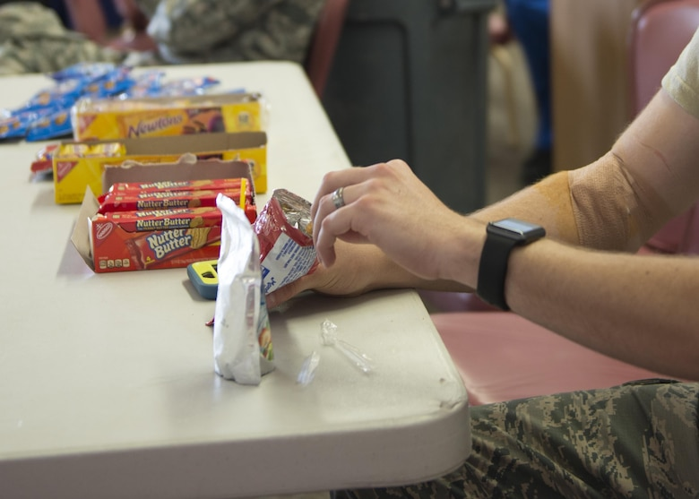 Staff Sgt. Scott, a 49th Materiel Maintenance Squadron heating, ventilation and air conditioning craftsman, eats a snack after having his blood drawn here May 17. Eating and drinking after donating blood replaces fluids, restores iron levels, and helps prevent light-headedness and dizziness. Donating blood is a simple process that can save lives in an emergency. (Last names are being withheld due to operational requirements. U.S. Air Force photo by Airman 1st Class Randahl J. Jenson)