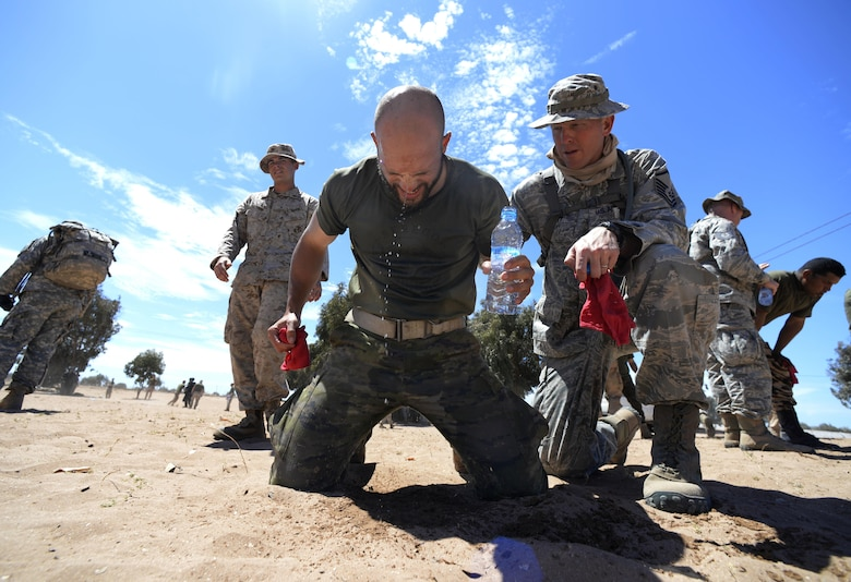 "A Spanish Legion soldier recovers with the help of a U.S. Air Force master sergeant after being exposed to Oleoresin Capsicum ""pepper"" spray during a non-lethal weapons class as a part of AFRICAN LION 16 at Tifnit, Kingdom of Morocco, April 23, 2016. Of the 11 nations participating in the annual exercise, a group of U.S. military members, Royal Moroccan armed forces members, Spanish Legion soldiers and Royal Netherlands army soldiers lived in field conditions and participated in daily familiarization with other nation's tactics to improve interoperability. (U.S. Air Force photo by Senior Airman Krystal Ardrey)"