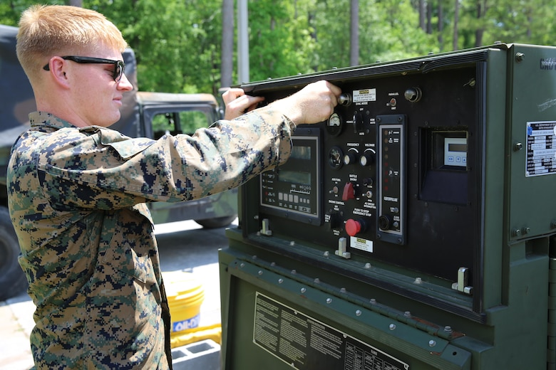 Lance Cpl. Arron Kristof turns off a generator prior to conducting an oil change during Marine Expeditionary Force Exercise 2016, at Marine Corps Air Station Cherry Point, N.C., May 11, 2016. MEFEX 16 is a command and control exercise conducted in a deployed environment designed to synchronize and bring to bear the full spectrum of II MEF's C2 capabilities in support of a Marine Air-Ground Task Force. Kristof is a utilities mechanic with Marine Wing Support Squadron 271. (U.S. Marine Corps photo by Lance Cpl. Mackenzie Gibson/Released)