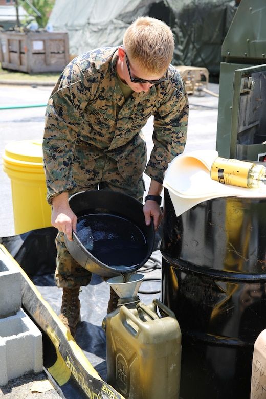 Lance Cpl. Arron Kristof empties oil from a generator into a container during Marine Expeditionary Force Exercise 2016, at Marine Corps Air Station Cherry Point, N.C., May 11, 2016. MEFEX 16 is a command and control exercise conducted in a deployed environment designed to synchronize and bring to bear the full spectrum of II MEF's C2 capabilities in support of a Marine Air-Ground Task Force. Kristof is a utilities mechanic with Marine Wing Support Squadron 271. (U.S. Marine Corps photo by Lance Cpl. Mackenzie Gibson/Released)