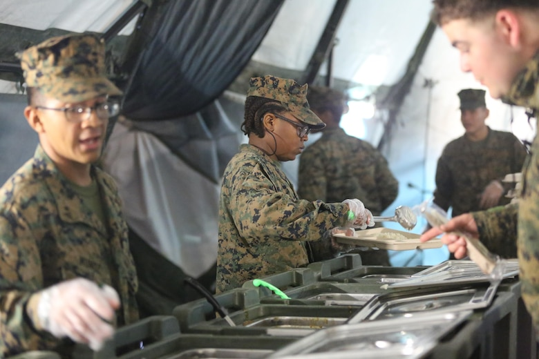 Food service specialists serve chow to more than 300 Marines, during Marine Expeditionary Force Exercise 2016, at Marine Corps Air Station Cherry Point, N.C., May 13, 2016. MEFEX 16 is designed to synchronize and bring to bear the full spectrum of II MEF's command and control capabilities in support of a Marine Air-Ground Task Force. (U.S. Marine Corps photo by Lance Cpl. Mackenzie Gibson/Released)