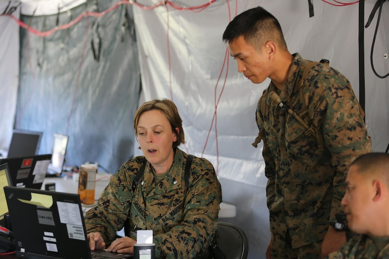 Lt. Col. Regina Gustavsson and Sgt. Peter Apiag discuss reporting requirements for their section for a simulated mishap during II Marine Expeditionary Force Exercise 16 at Marine Corps Air Station Cherry Point, N.C., May 15, 2016. MEFEX 16 is a command and control exercise conducted in a deployed environment designed to synchronize and bring to bear the full spectrum of II Marine Expeditionary Force's C2 capabilities in support of a Marine Air-Ground Task Force. Gustavsson is the assistance chief of staff for G-1 and Apiag is an admin clerk with MWHS-2.(U.S. Marine Corps photo by Lance Cpl. Mackenzie Gibson/Released)