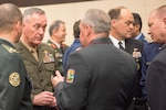 Marine Corps Gen. Joe Dunford, chairman of the Joint Chiefs of Staff, talks with military leaders attending the NATO Military Committee/Chiefs of Defense Session in Brussels, May 18, 2016. DoD photo by D. Myles Cullen