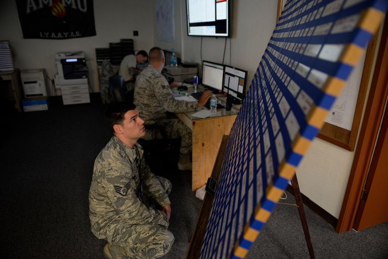 "U.S. Air Force Staff Sgt. Jason Lemmond, 18th Munitions Squadron maintenance crew lead, checks the ""Frag Board"" to make sure that all of the bomb building is being completed on schedule during a week-long Pacific Air Forces Combat Ammunition Production Exercise May 16, 2016, at Kadena Air Base, Japan. The exercise is a Pacific Air Forces exercise held annually to test the munitions Airmen's ability to build ammunition for wartime aircraft. (U.S. Air Force photo by Senior Airman Stephen G. Eigel/Released)"
