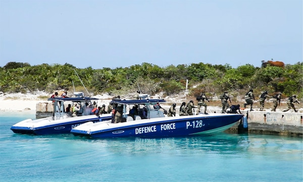 NASSAU, Bahamas (MAY 10, 2016) Members of the Royal Bahamas Defence Force exit a patrol boat during a simulated assault for Exercise Marlin Shield May 10, 2016.  Marlin Shield aims to promote interoperability between the RBDF, U.S. Northern Command and U.S. Special Operations Command North and allows both nations to practice combating terrorism and illicit trafficking in the Caribbean region.