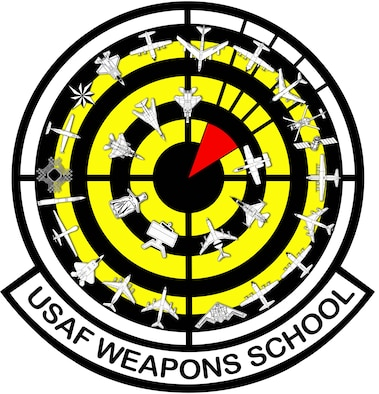 """The current Weapons School patch design, adopted in 2016, reflects the expansion of the school, with 28 aircraft and weapons systems encircling a red """"bomb on target"""" over a black and yellow bullseye background."""