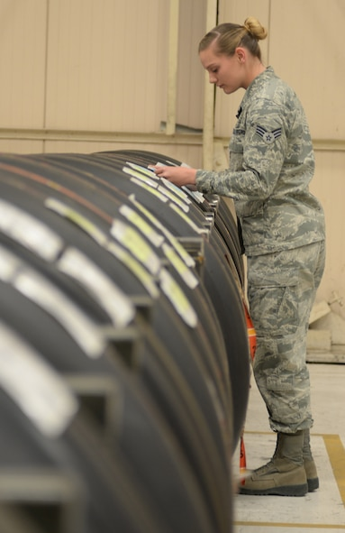 Senior Airman Jessica Stainbrook, 28th Logistics Readiness Squadron aircraft parts store journeyman, inspects a tire to ensure that it is mission ready at Ellsworth Air Force Base, S.D., April 25, 2016. The flight supplies parts to B-1 bomber locations, and once the item is processed, an automatic replenishing code ensures sent items are replaced to be used in the future. (U.S. Air Force photo by Airman 1st Class Sadie Colbert/Released)