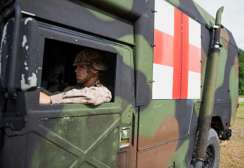 A Marine assigned to Surgical Company B, 4th Medical Battalion, drives an ambulance during a five-day medical field exercise May 13, 2016 at Joint Base Charleston, S.C. The exercise tested the capabilities of Surgical Company B's forward resuscitative surgical system, or FRSS, which is a rapidly mobile trauma surgical team designed to be in close proximity to combat units on the battlefield. (U.S. Air Force photo/Staff Sgt. Jared Trimarchi)
