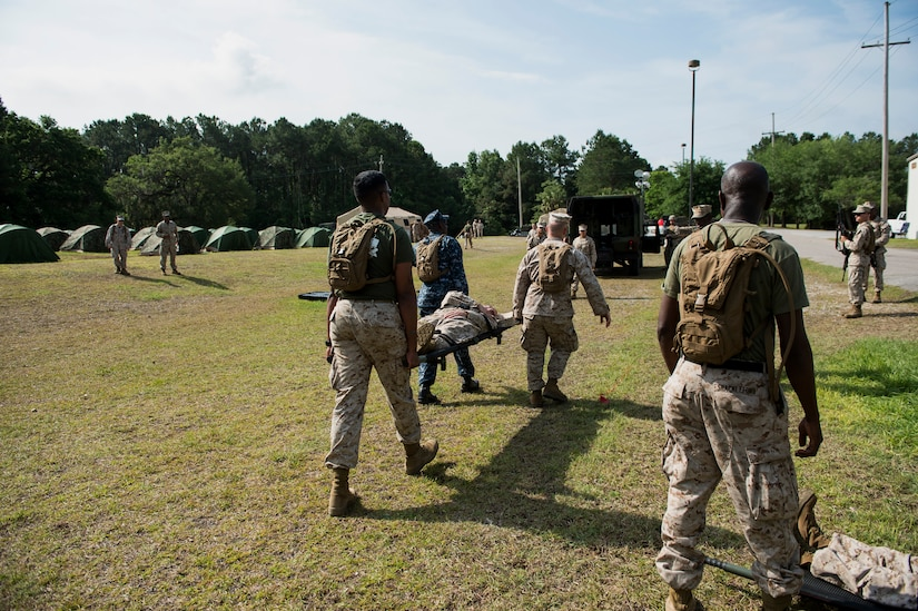 Sailors assigned to Surgical Company B, 4th Medical Battalion, transport a simulated patient during a five-day medical field exercise May 13, 2016 at Joint Base Charleston, S.C. The exercise tested the capabilities of Surgical Company B's forward resuscitative surgical system, or FRSS, which is a rapidly mobile trauma surgical team designed to be in close proximity to combat units on the battlefield. (U.S. Air Force photo/Staff Sgt. Jared Trimarchi)
