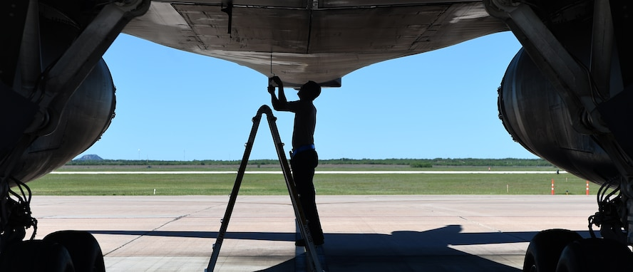 U.S. Air Force Senior Airman Jason Stach, 28th Aircraft Maintenance Unit B-1 aircraft technician, disengages the mechanical controls for the rear weapons bay doors May 3, 2016, at Dyess Air Force Base, Texas. Stach originally worked in the isochronal hangar as an inspector where they disassemble B-1s and check the components for wear and tear. He is currently responsible for basic maintenance and inspections before flights. (U.S. Air Force photo by Senior Airman Alexander Guerrero/Released)